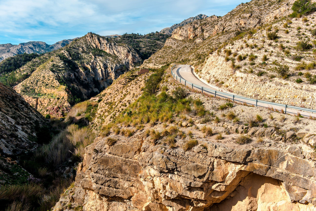 Scenic rocky mountains, road to the El Salt in Jijona. Spain Alicante, Spain Cliffs El Salt Europe Geology Jijona Landscape Mountain Road Mountains Nature Outdoors Picturesque Road Rock Formation Rocky Rocky Mountains Scenery SPAIN Sunny Day Travel Valencia, Spain Valley View Xixona