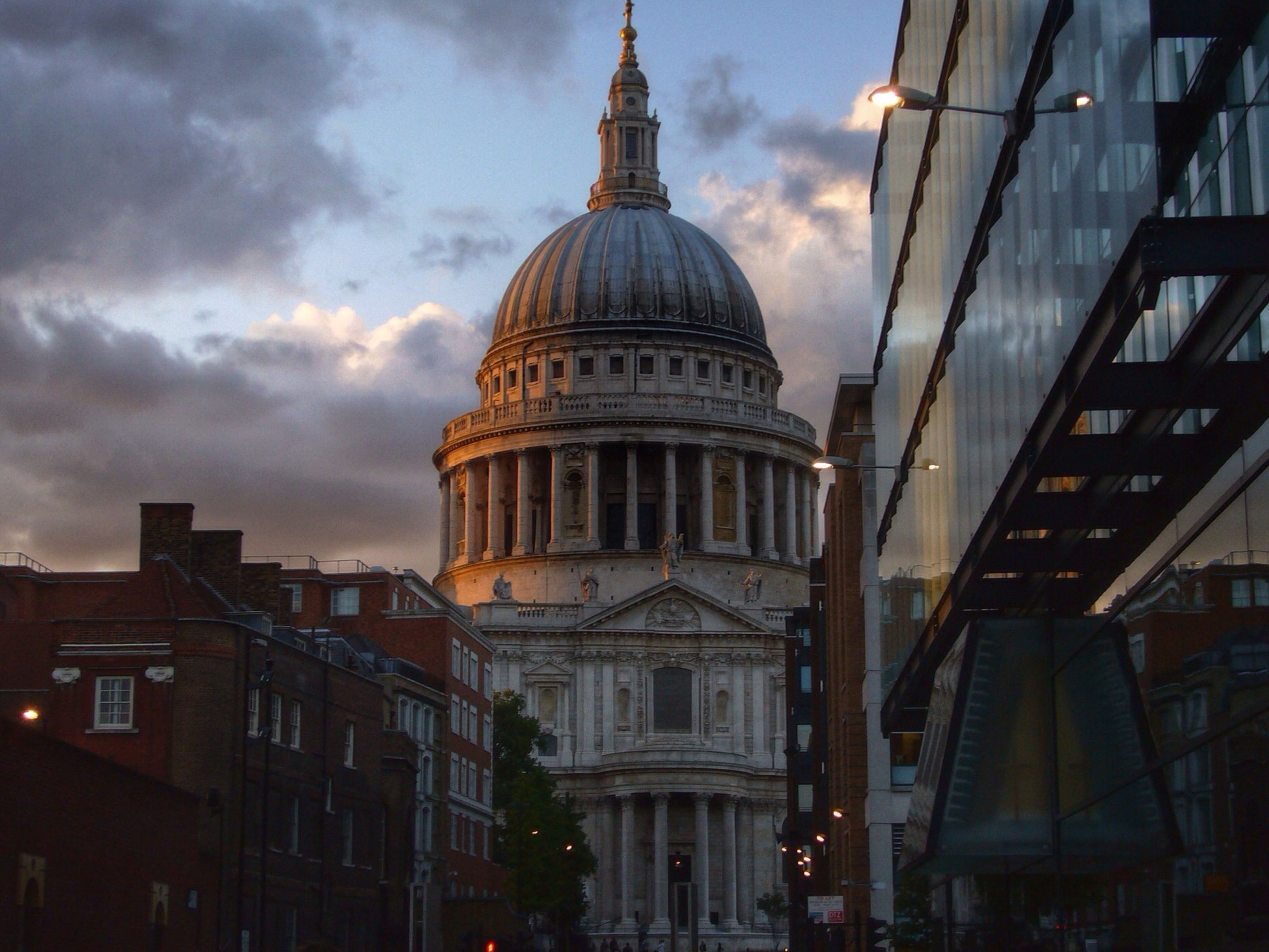architecture, built structure, building exterior, sky, cloud - sky, low angle view, cloudy, city, cloud, modern, tower, tall - high, building, dusk, outdoors, travel destinations, no people, capital cities, sunset, famous place