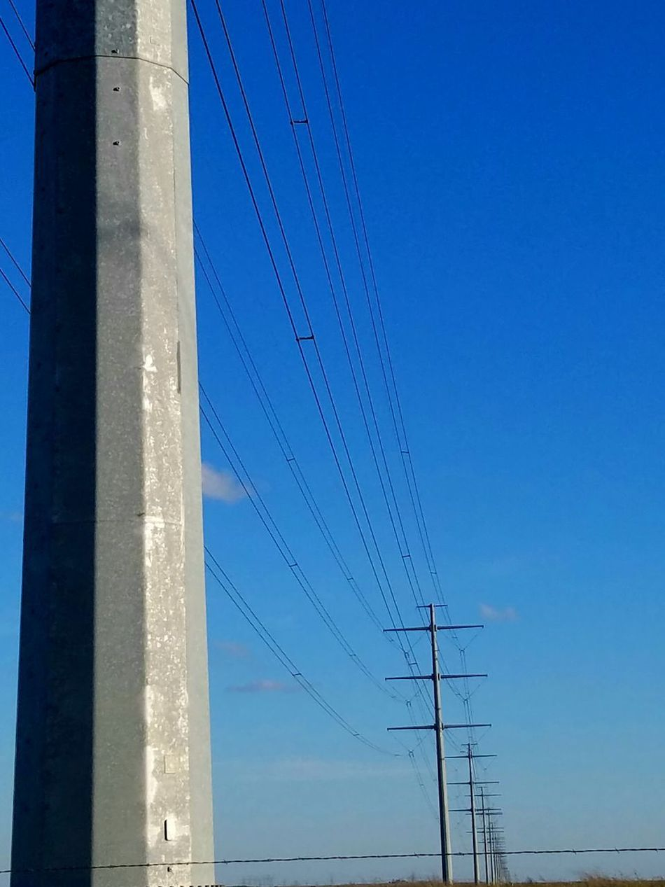 Cable Connection Power Line  Electricity  Blue Power Supply Electricity Pylon Day Fuel And Power Generation Sky No People Outdoors Clear Sky Telephone Line Technology Nature Parallel Bird Close-up