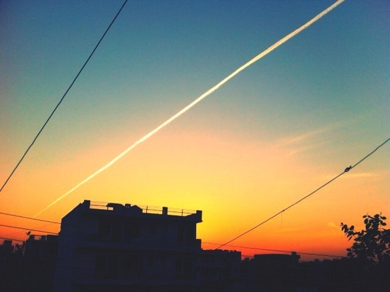 sunset, cable, no people, silhouette, outdoors, built structure, nature, architecture, building exterior, sky, contrail, vapor trail, clear sky, beauty in nature, day