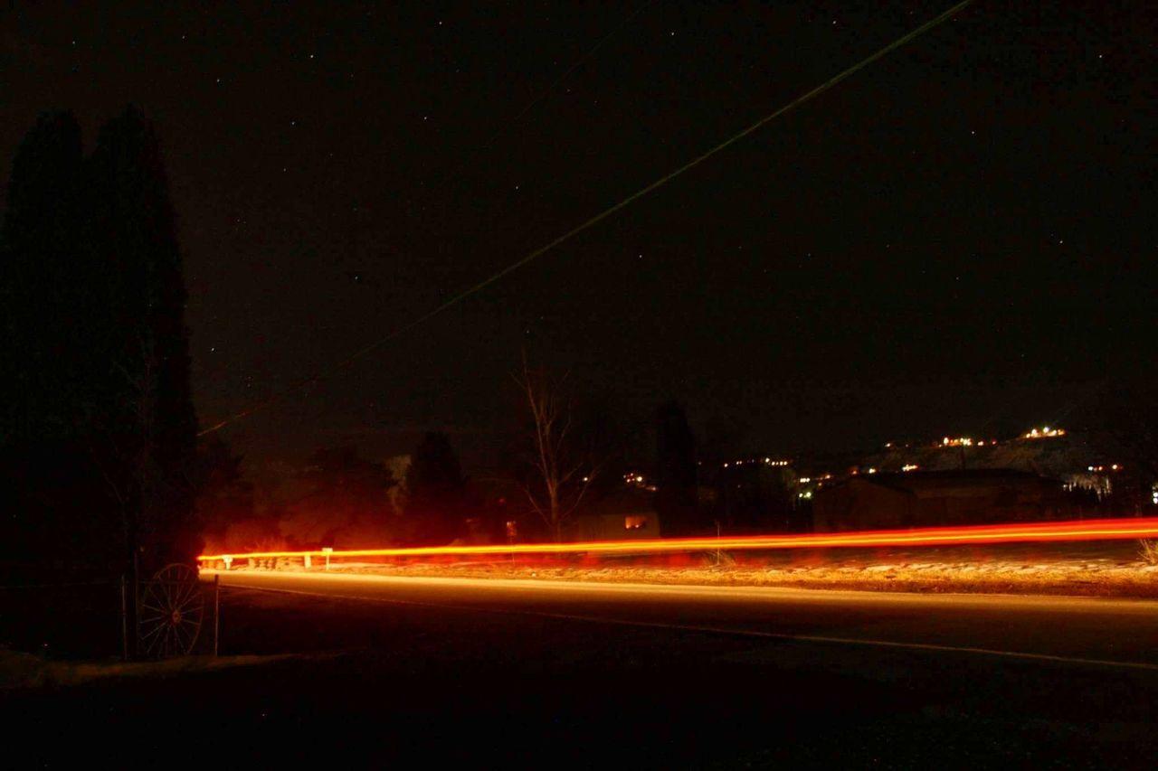 night, illuminated, light trail, long exposure, speed, motion, blurred motion, transportation, outdoors, road, no people, high street, street light, nature, sky