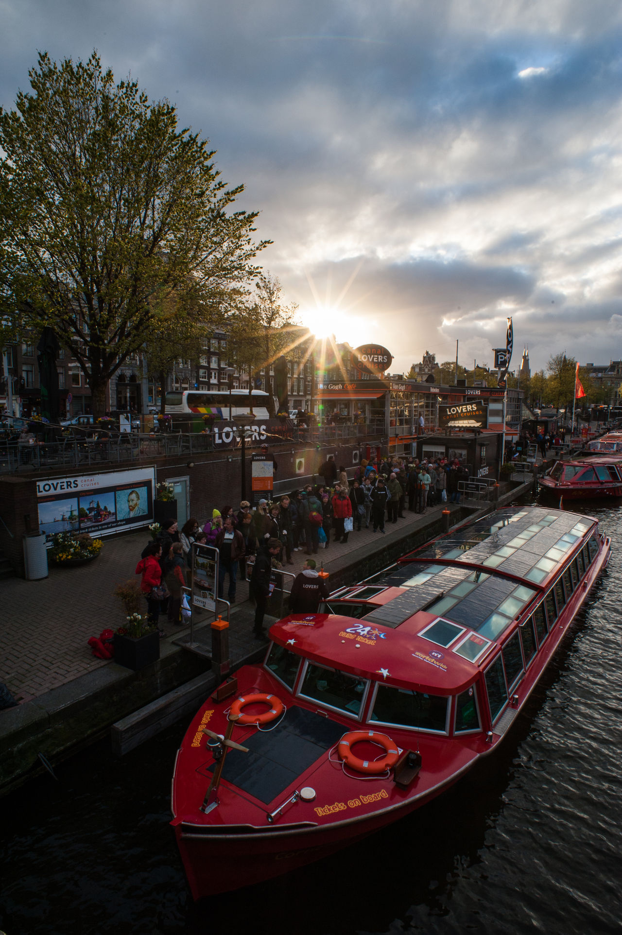 Boat and sunset Amsterdam Architecture Boat Building Exterior Built Structure City Cloud - Sky Day Lovers Mode Of Transport Nautical Vessel Outdoors Rondvaartboot Sky Sunset Transportation Tree Water