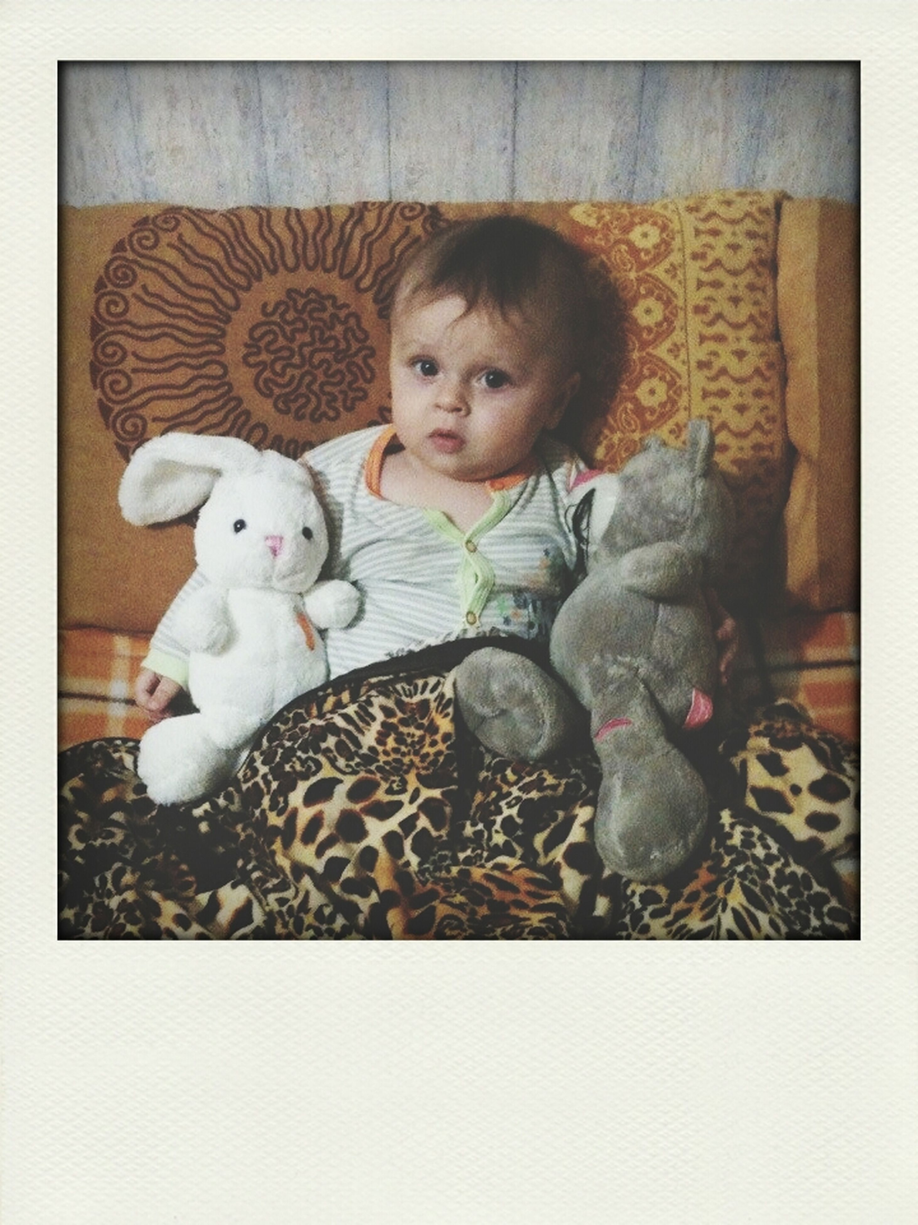 transfer print, childhood, portrait, auto post production filter, cute, looking at camera, indoors, animal themes, innocence, pets, full length, elementary age, toy, person, togetherness, relaxation, domestic animals, playful, baby, sitting