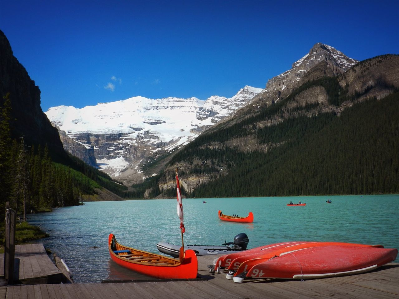 Alberta, Canada Beauty In Nature Blue Canada Canoes Clear Sky Day Lake Mountain Mountain Range Nature Nautical Vessel No People Outdoors Scenics Sky Snow Snowcapped Mountain Tranquil Scene Tranquility Water Winter