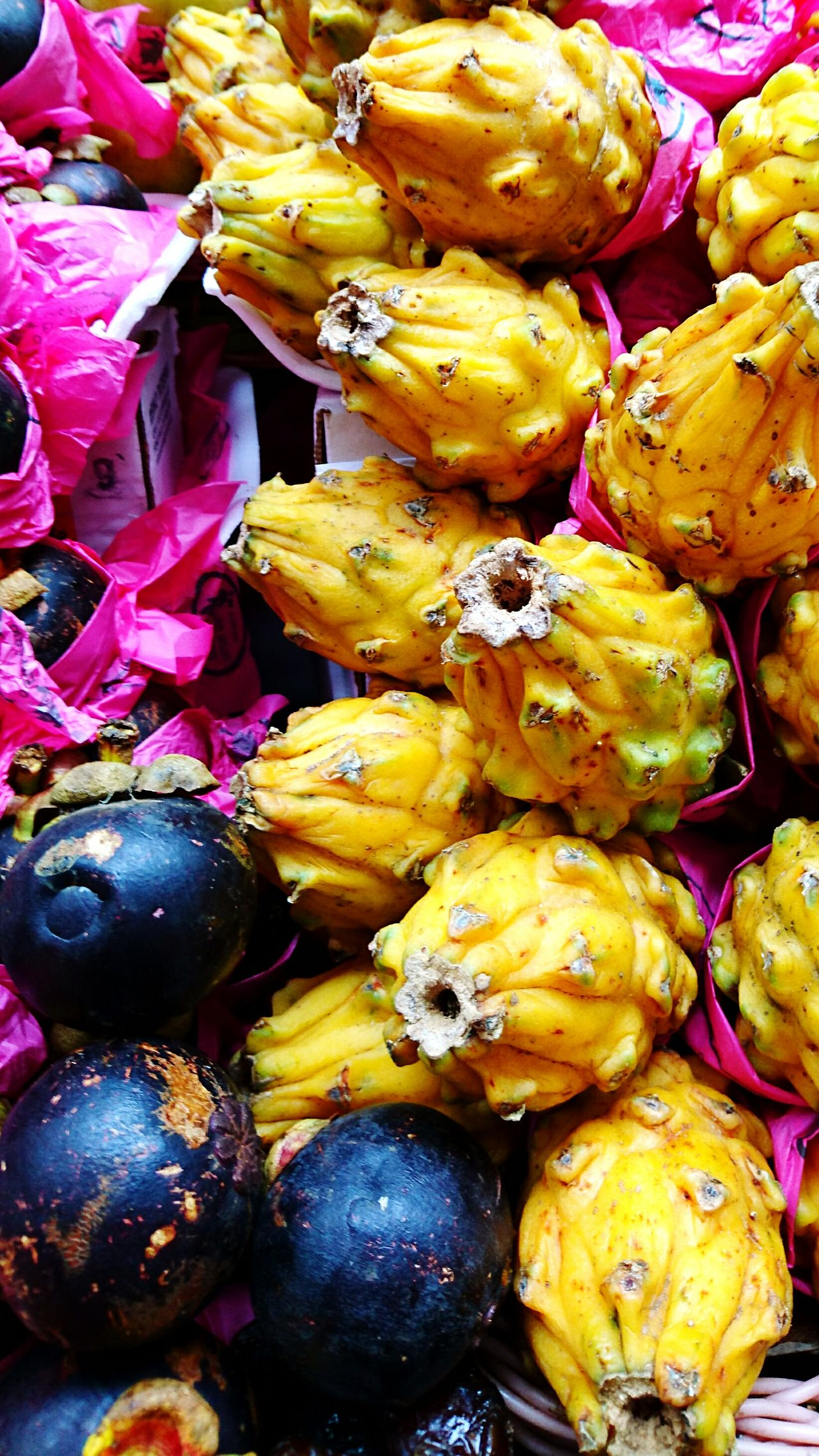 Exotic fruits: Mangostin (the black one) and Yellow Pitaya. Food Food And Drink Variation Freshness Multi Colored Large Group Of Objects Backgrounds Ready-to-eat Market Photograph Photographer Photo Eye4photography  Photography Eyeemphotography Sony Xperia Colors Sony Malephotographerofthemonth Mangostin Pitaya Yellow Pitaya Exotic Exotic Fruit Exotic Fruits