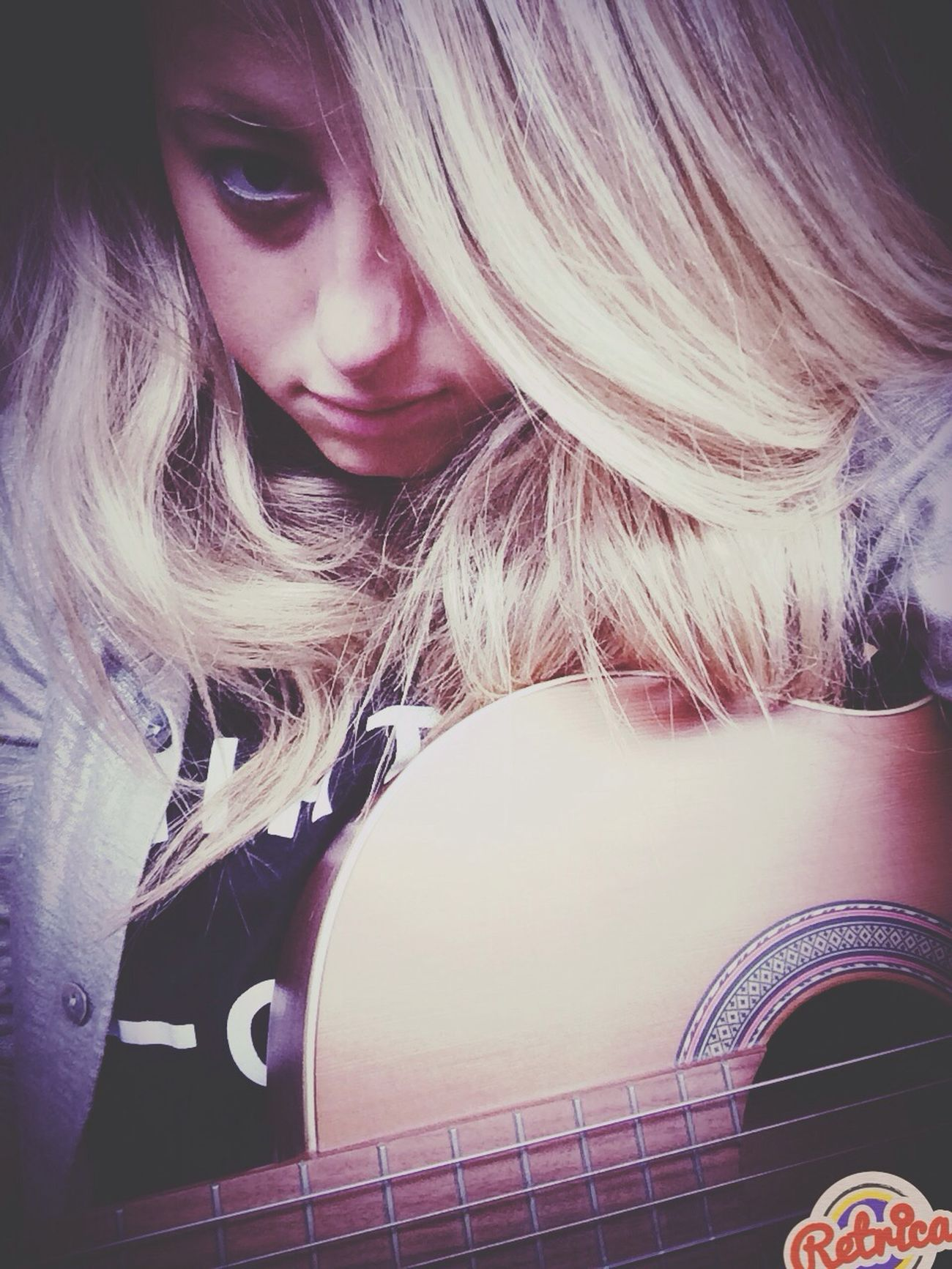 """ We were once so strong, our love is like a song, you can't forget it. "" - Demi lovato Playing The Guitar ?????"