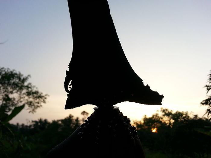 Silhouette Sunset Malaysia Kuantan an antique malaysian dagger (keris, kris)