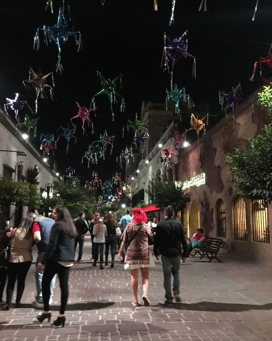 People Celebration Outdoors Night Walking Around Illuminated City Street Nightlife City Street Color Explosion Piñata