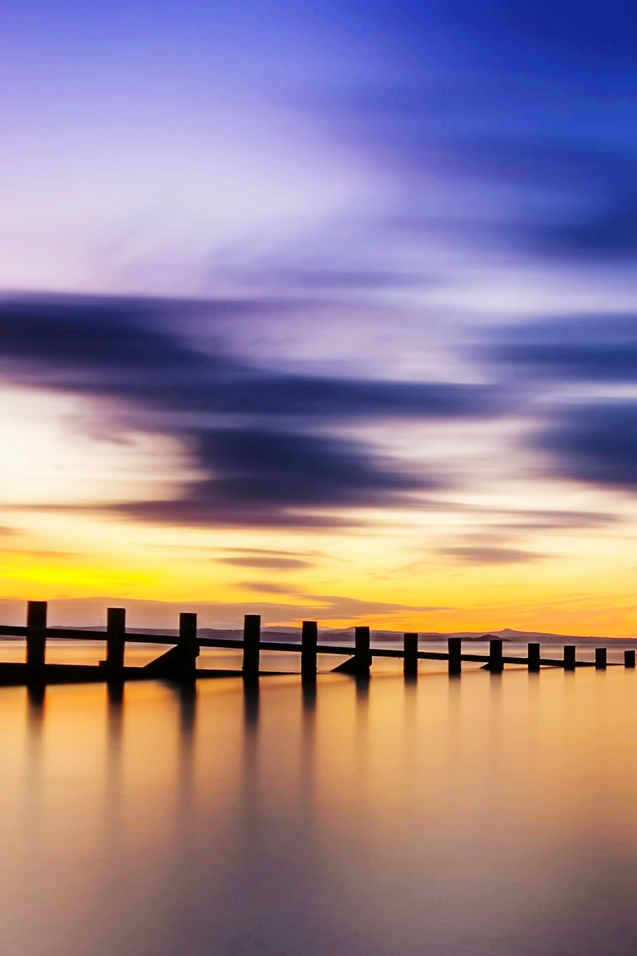 sunset, sea, wooden post, scenics, cloud - sky, sky, reflection, silhouette, nature, tranquility, horizon over water, water, no people, outdoors, beauty in nature, day