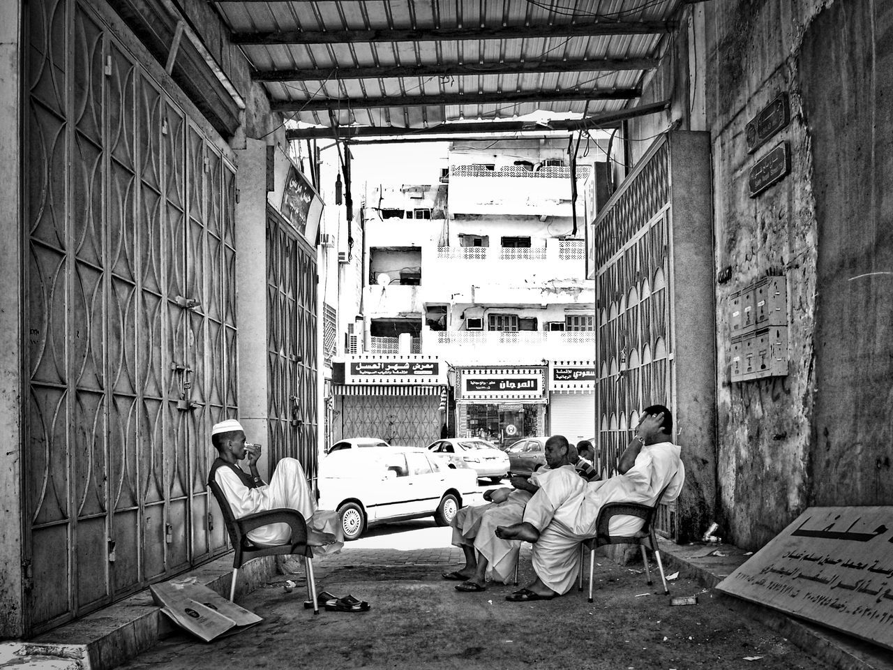 Arab Arabic Arabic Style Black & White City Life City Street EyeEm Best Shots - Black + White Hanging Around Jeddah Leisure Time Monochrome Photography Old Fashioned Old Town People People And Places People Photography Portrait Saudi Arabia Simple Moment Sitting Street Photography Streetphotography Togetherness Urban Exploration Urban Lifestyle