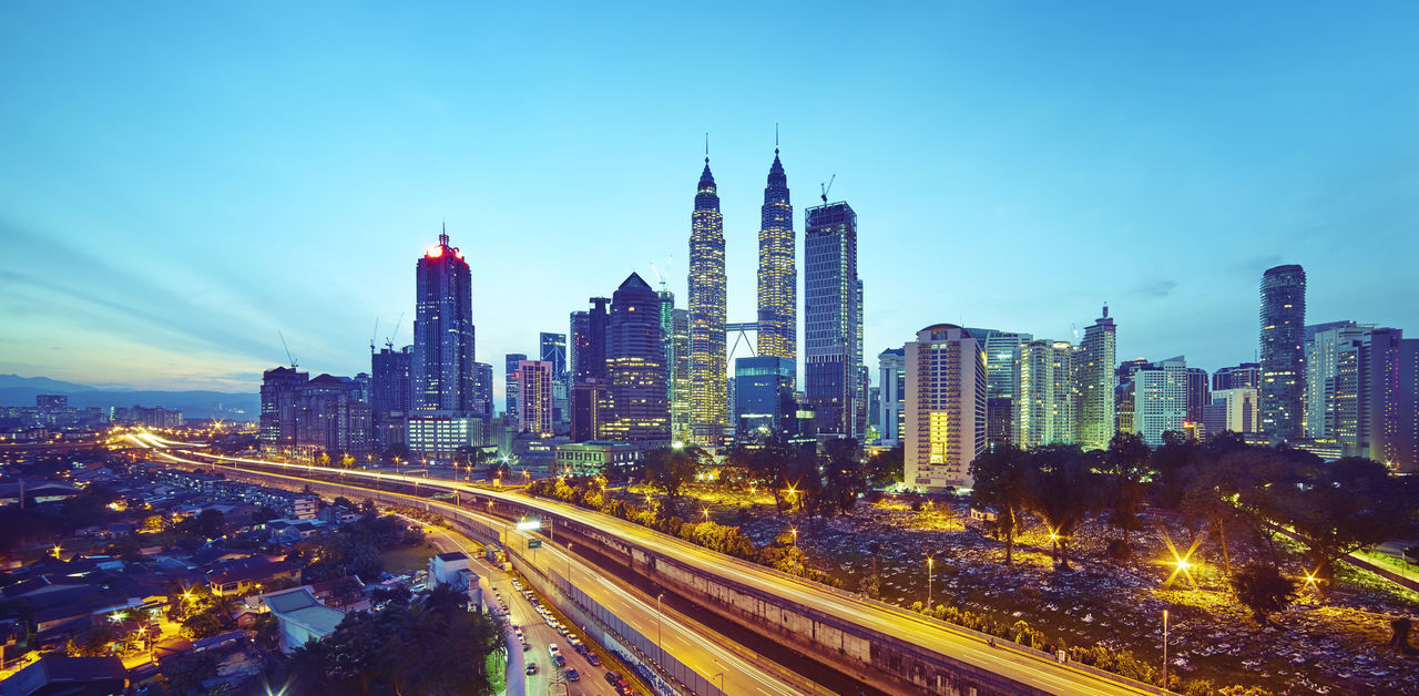 Kuala Lumpur city skyline at twilight, Malaysia . Architecture Building Exterior Built Structure Business Business Finance And Industry Car City City Life City Street Cityscape Development Highway Illuminated Modern Night Outdoors Road Skyscraper Speed Tower Traffic Transportation Travel Destinations Urban Skyline