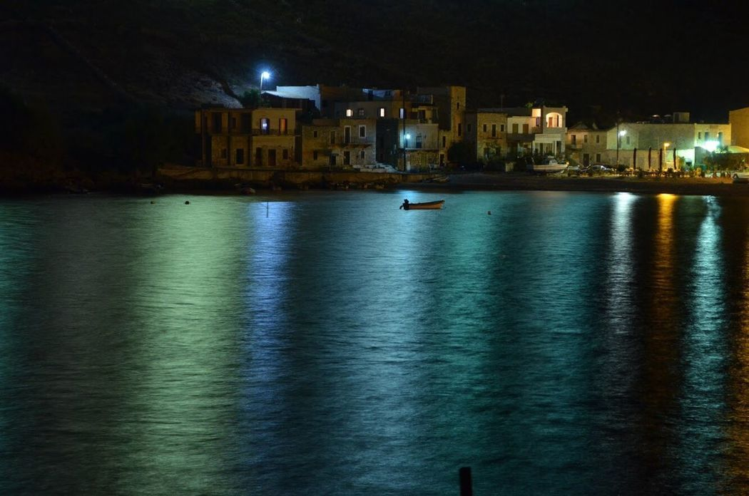 Nightlights Reflection in the Sea . Summer night in Gerolimenas , Mani , Greece . Calmness Nightphotography