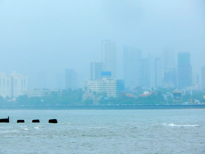 5miles Away Monsoonrains Battle Of The Cities People And Places Color Of Technology Water Waterfront Sea City Tranquility Tranquil Scene Fog Calm Skyscraper Sky Scenics Day Foggy Outdoors Mist Tall Ocean Beauty In Nature Tall - High Seascape