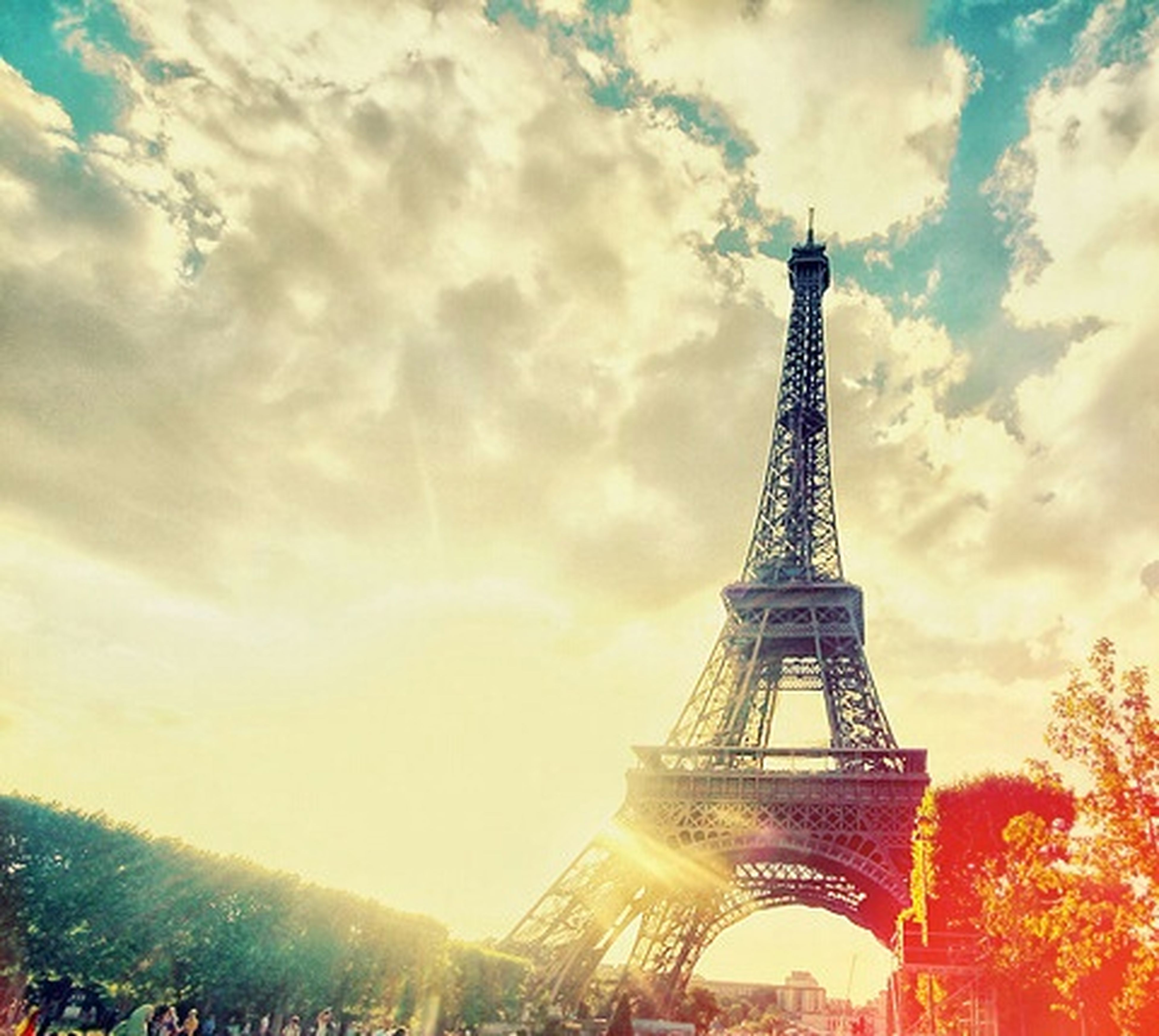 architecture, eiffel tower, built structure, famous place, international landmark, travel destinations, tower, sky, tourism, tall - high, capital cities, travel, culture, cloud - sky, low angle view, metal, building exterior, city, cloudy, history