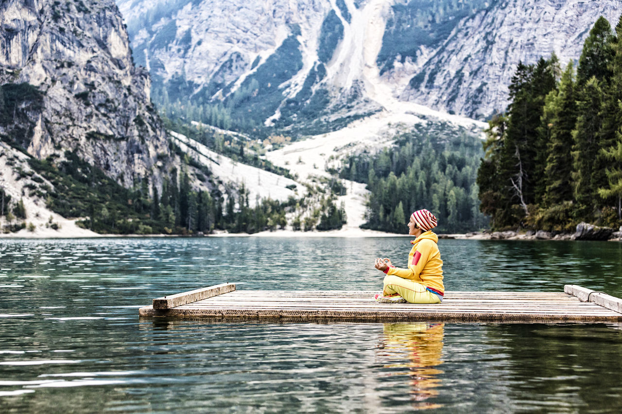 Yoga at the lake Adventure Alone Asana Asanas Beauty In Nature Calm Dolomites Enjoy Float Lake Meditation Mind  Mindfulness Moment Mountain Nature One Person Outdoors Pose Prags Pragser Wildsee Raft Recreation  Scenery Yoga Miles Away