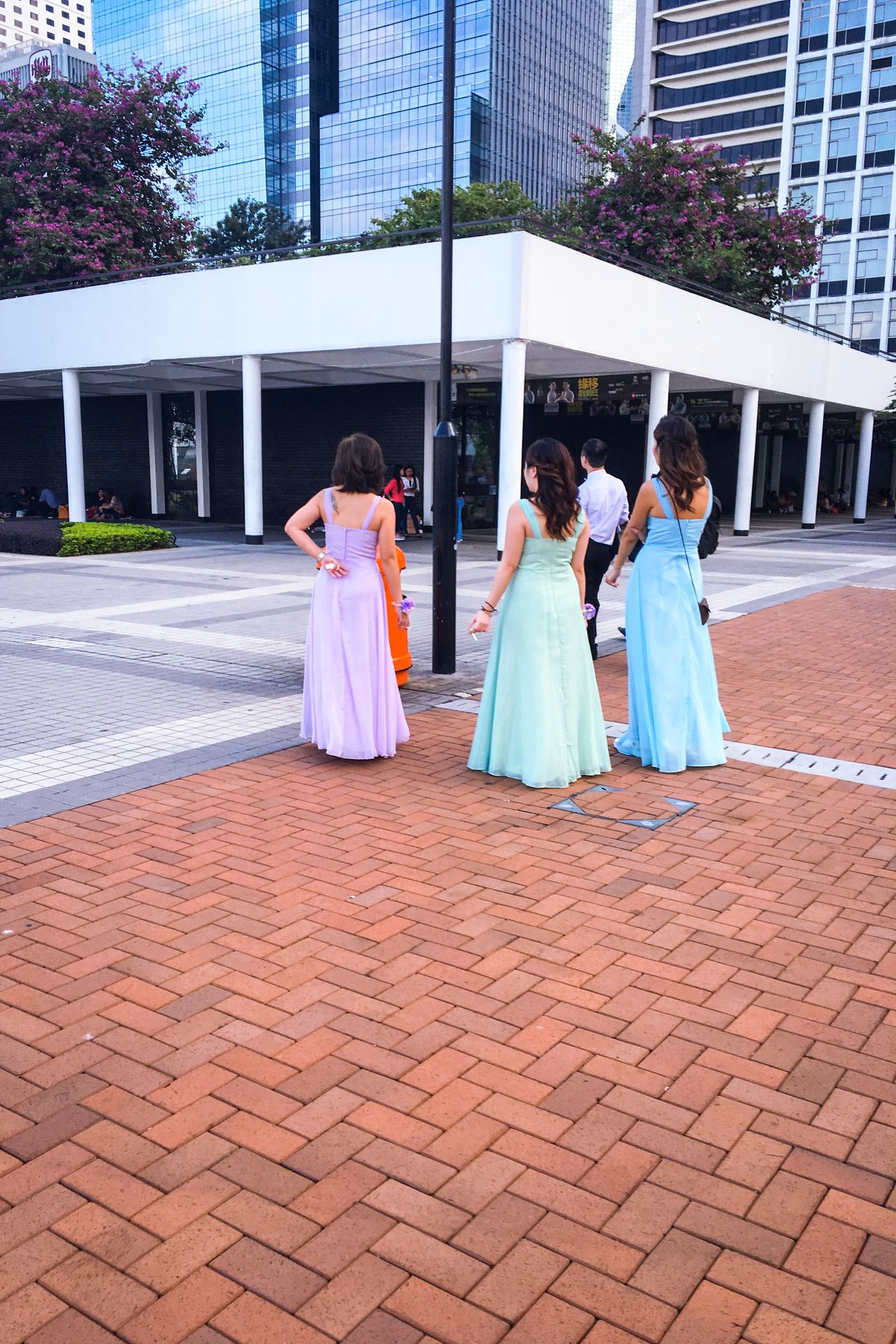 Streetphotography Streetphoto_color Candid Bridemaids Waiting Smoking Ashtray  Snapshots Of Life Wedding Photography Break Looking At Things Dresses Pastel Showcase: November Wedding Wedding Around The World Women Who Inspire You The Following Girl Power