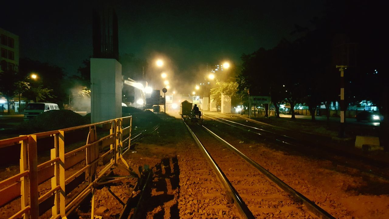 Night Illuminated Outdoors No People Sky Rail Railroad Track Railway Railroad Railway Track Railroad Tracks Railways Night Lights Nightphotography Nightscape Long Exposure Pathway Landscape Backgrounds Train Train Station Train Track Traintracks Working Construction Site