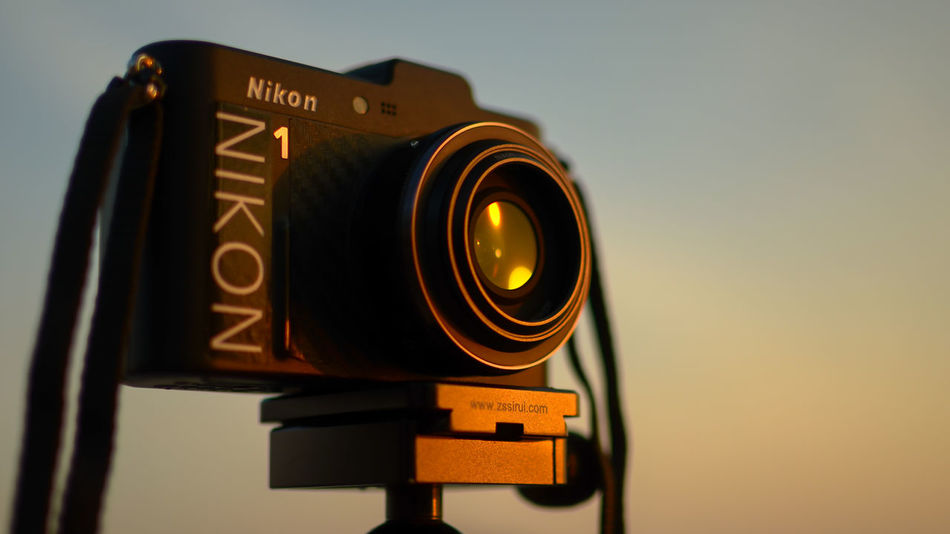 Digial camera on tripod with blured background (Nikon 1 V1 camera) Blurred Background Close-up Equipment Hobbies Nikon Nikon 1  Nikon 1 V1 Nikon V1 Outdoors Photography Photography Themes Scenics Sea Sky Sunset Technology Travel Tri Pod View