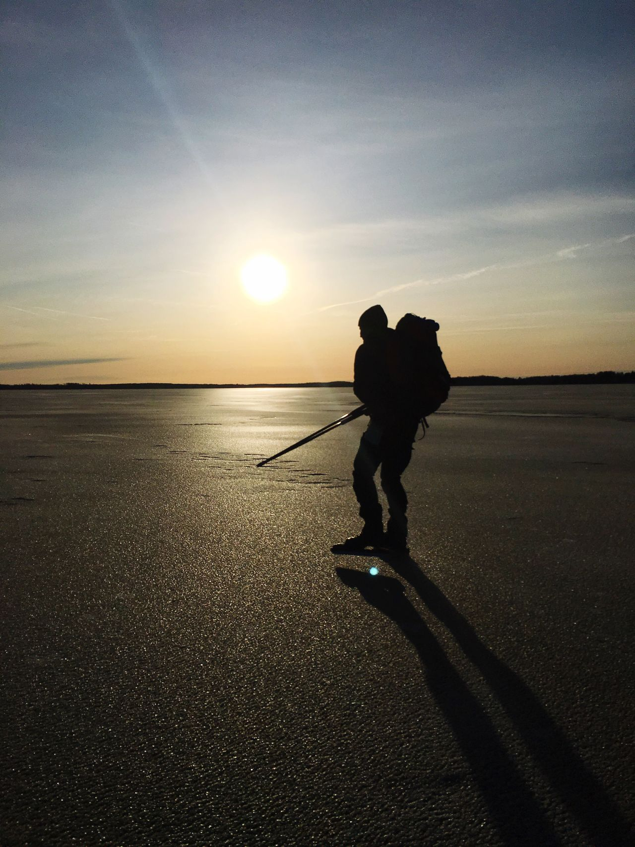 Long Distance Skating Frozen Nature Frozen Rucksack Packsack Winter Sun Sun Winter Activities Backpack Ice Pick Ice Rod Winter Pick Ice Outdoors Silhouette Shadow On Ice Sunset Touring Skates Nordic Skates Ice Skating Skates Rod Snow Sports