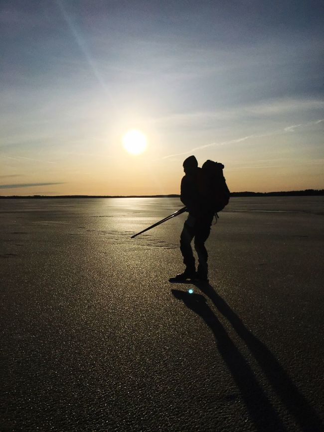 The Great Outdoors With Adobe Frozen Lake Frozen Nature Frozen Rucksack Packsack Winter Sun Sun Winter Activities Backpack Ice Pick Ice Rod Winter Pick Ice Outdoors Silhouette Shadow On Ice Sunset Touring Skates Nordic Skates Ice Skating Skates Rod