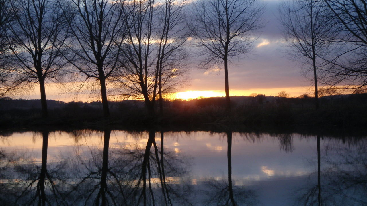 Bare Tree Beauty In Nature Calm Cloud - Sky Constablecountry Idyllic Lake Majestic Nature No People Orange Color Outdoors Reflection Scenics Silhouette Sky Standing Water Stour Stratford St Mary Sun Sunset Tranquil Scene Tranquility Tree Water