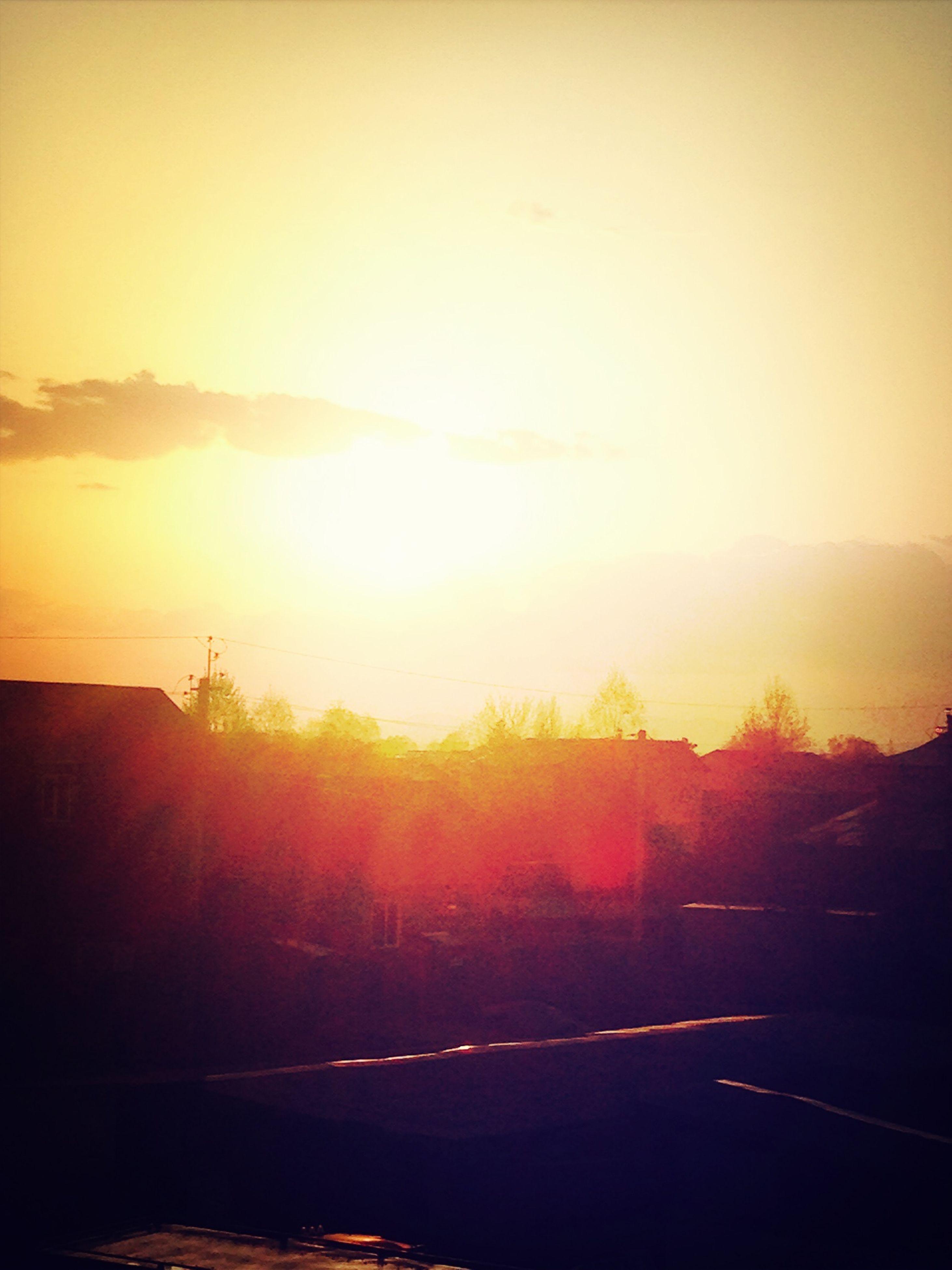 sunset, sun, silhouette, orange color, sky, sunlight, scenics, tranquility, tranquil scene, beauty in nature, sunbeam, lens flare, road, nature, transportation, idyllic, tree, landscape, outdoors, back lit