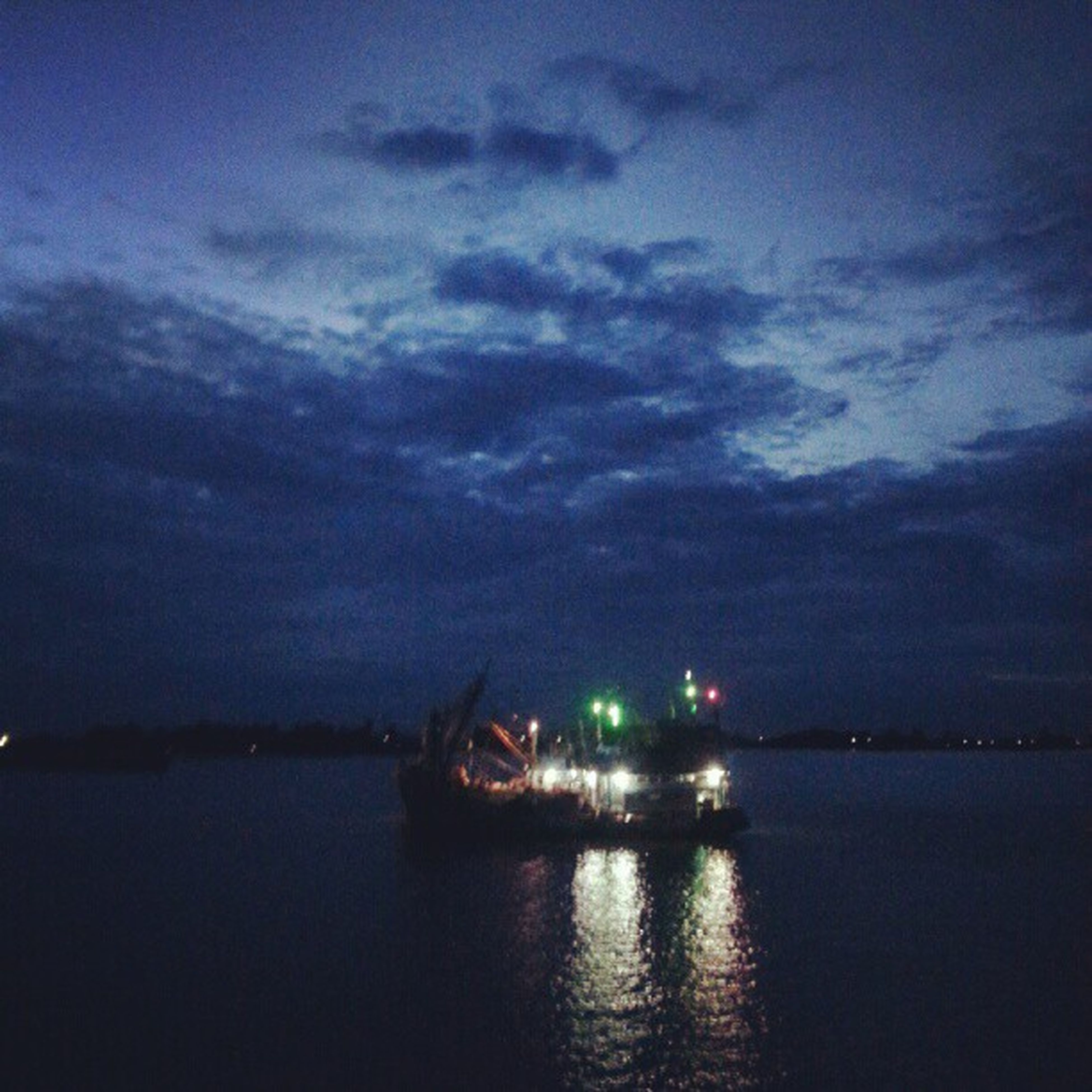 water, waterfront, nautical vessel, sky, transportation, mode of transport, boat, cloud - sky, sea, illuminated, reflection, tranquility, tranquil scene, scenics, beauty in nature, night, nature, river, dusk, cloud