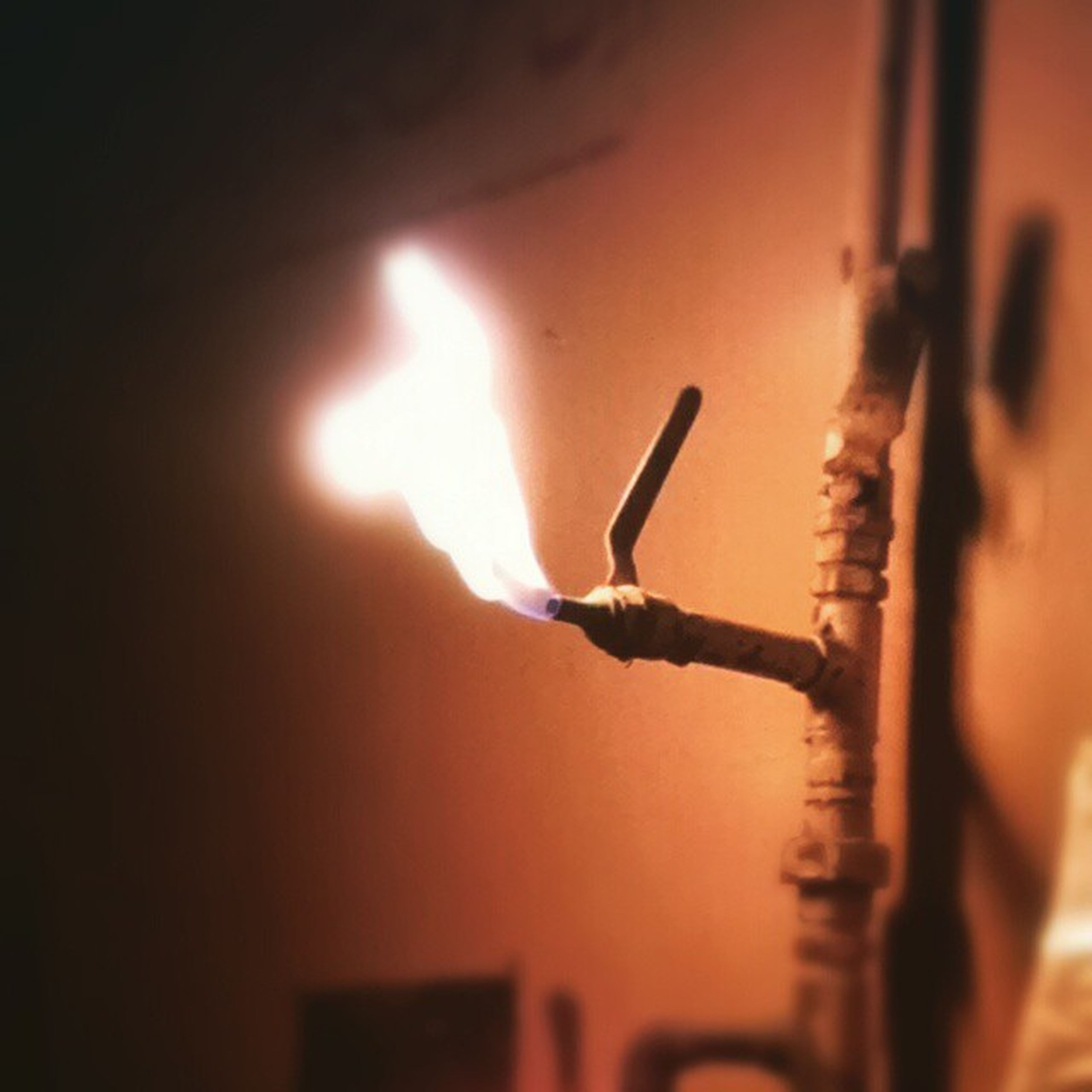 burning, flame, fire - natural phenomenon, indoors, illuminated, night, glowing, heat - temperature, close-up, selective focus, orange color, focus on foreground, light - natural phenomenon, fire, sunset, dark, motion, lit, danger, silhouette