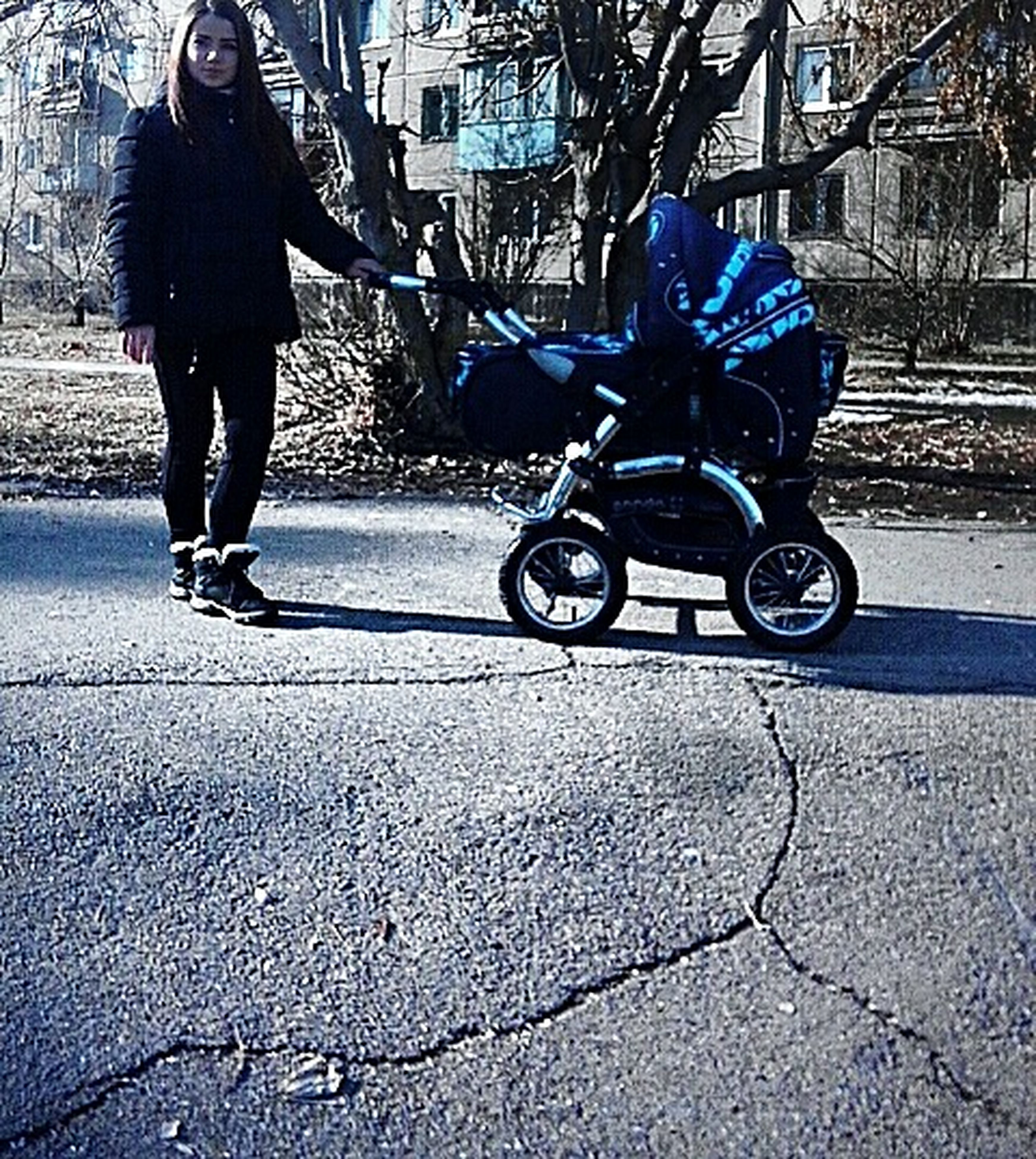 shadow, lifestyles, full length, one person, adults only, outdoors, day, adult, baby stroller, real people, people, women, only women, low section