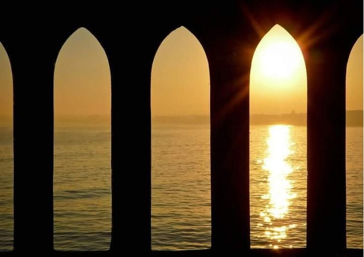 sunset Arch Day Nature No People Orange Color Outdoors Reflection Sea Shiny Silhouette Sky Sun Sunset Water