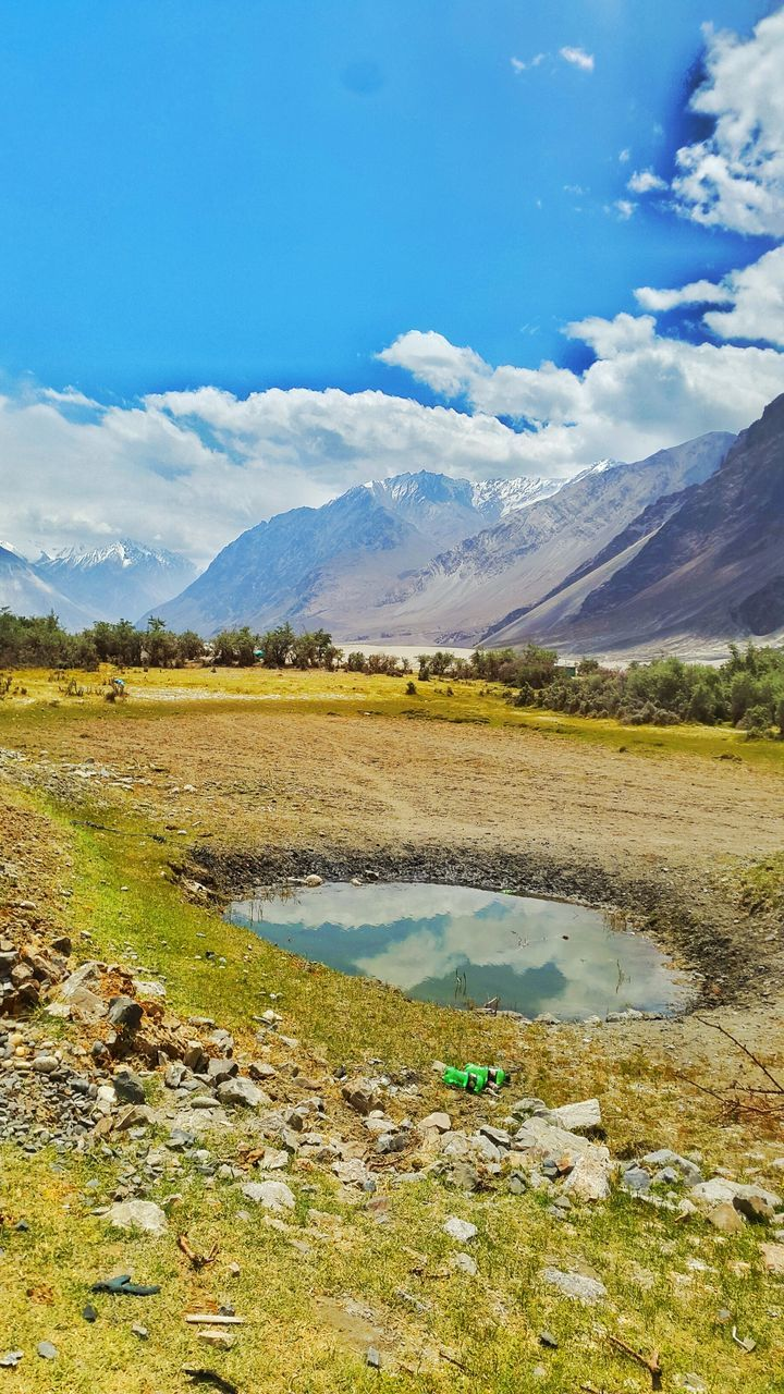 nature, landscape, scenics, beauty in nature, tranquil scene, tranquility, sky, field, mountain, day, outdoors, no people, water, lake, cloud - sky, mountain range, rural scene, grass, salt - mineral