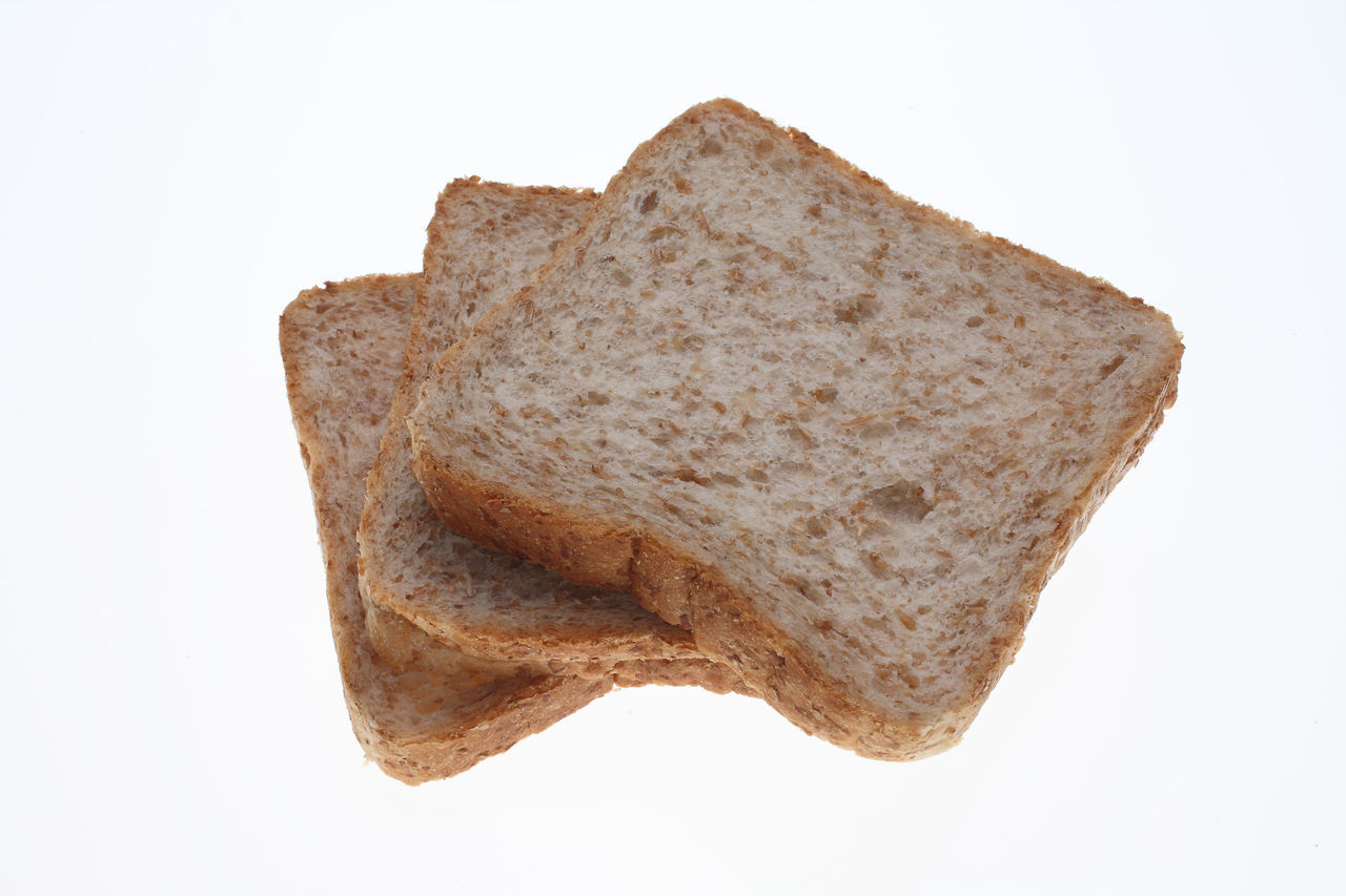 slices of Wholemeal toast bread on white Bread Brown Close-up Cut Out Detail Geometric Shape No People Single Object Slices Stone Studio Shot Symbol Toastbread Toast🍞 White Background Wholemeal Wholemeal Bread