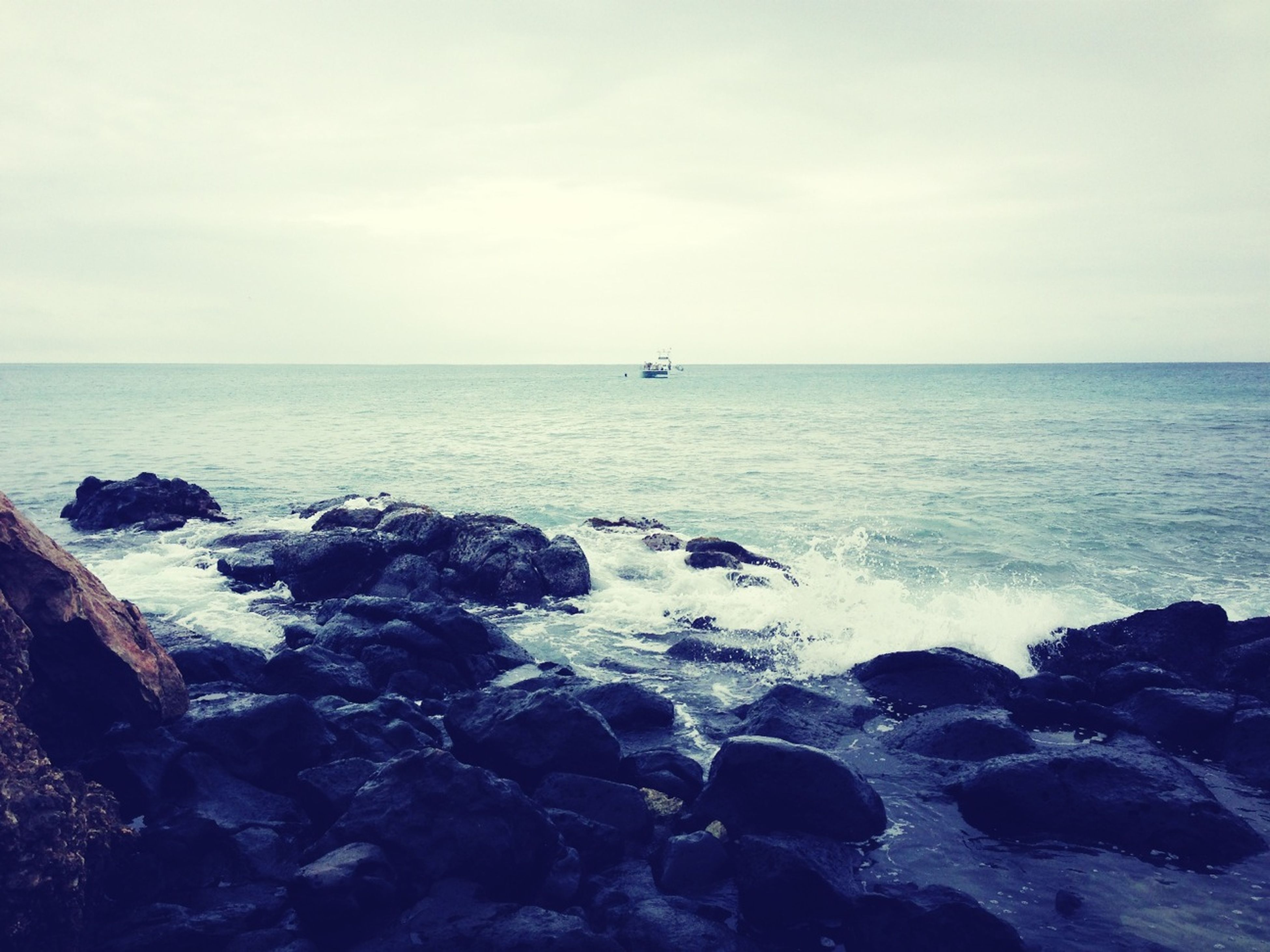 sea, horizon over water, water, scenics, beauty in nature, sky, rock - object, tranquil scene, tranquility, beach, wave, shore, nature, seascape, idyllic, surf, rock, rock formation, outdoors, remote