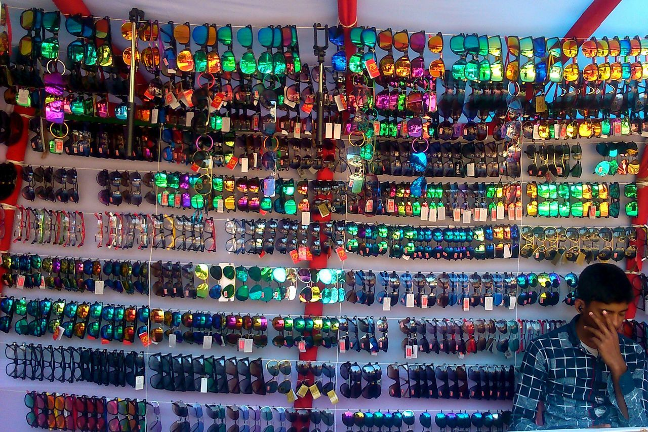 Multi Colored Variation Choice Large Group Of Objects Indoors  Real People One Person Adults Only People Day Adult Asian Culture Rare View Uniqueness Bangladesh In Colors Adapted To The City Scenics EyeEmNewHere Artistic Photography Bangladesh 🇧🇩 Freshness Sunglass  Sunglasses ✌👌 Close-up