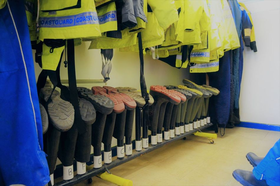 Coastguard Kit Coastguard Kit Hanging Indoors  Initials Locker Room No People Reflective Clothing Safety First Wellington Boots Wet Gear