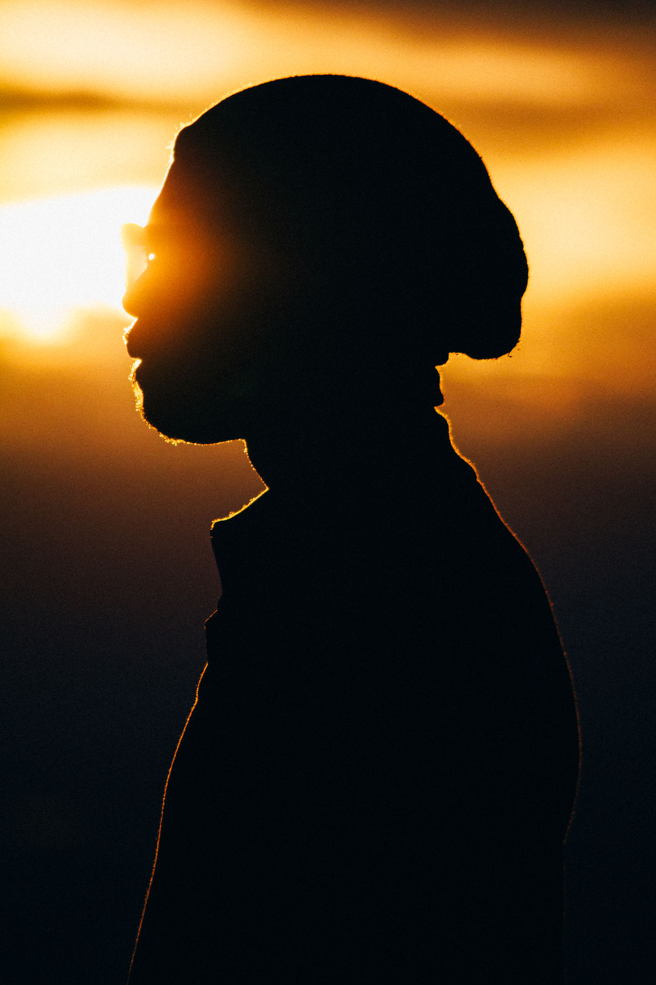 Adult Back Lit Close-up Day Human Body Part Males  Men One Man Only One Person One Young Man Only Only Men People Person Silhouette Sunglasses Sunset Sunset Silhouettes Vertical Young Adult Majestic Magic Hour Light Dark Single Evening
