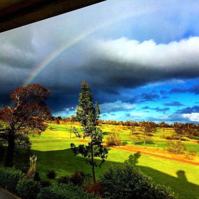 Rainbow with the sun shining over Whittlebury Hall golf course in Northamptonshire Golf Course Rainbow Sun Sunshine Green Course Rain Whittleburypark Whittleburyhall Whittlebury Hall Northants Northamptonshire Uk United Kingdom