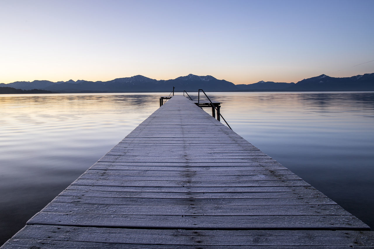 Stand up very early in the morning to catch this beautiful sunrise in frosty conditions at the Chiemsee. Alps Beautiful Beauty In Nature Blue Bridge Built Structure Clear Sky Ice Lake Landscape Mountain Nature Nature Photography Nature_collection Outdoors Peaceful Reflection Relaxing Scenics Silhouette Sky Sunrise Sunshine Water Wood - Material