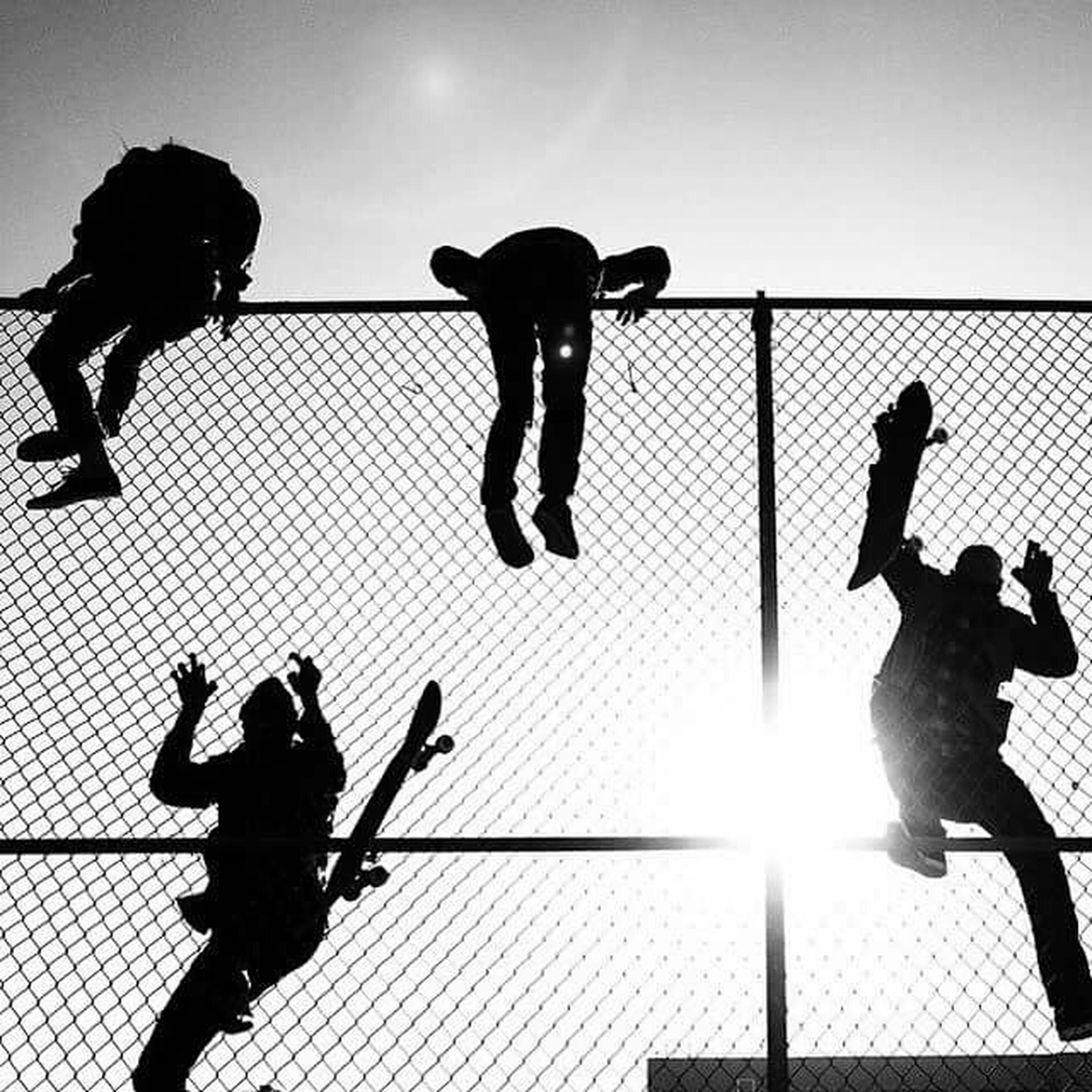 silhouette, men, lifestyles, leisure activity, togetherness, person, enjoyment, bonding, sunlight, medium group of people, photographing, full length, sky, friendship, shadow, low angle view