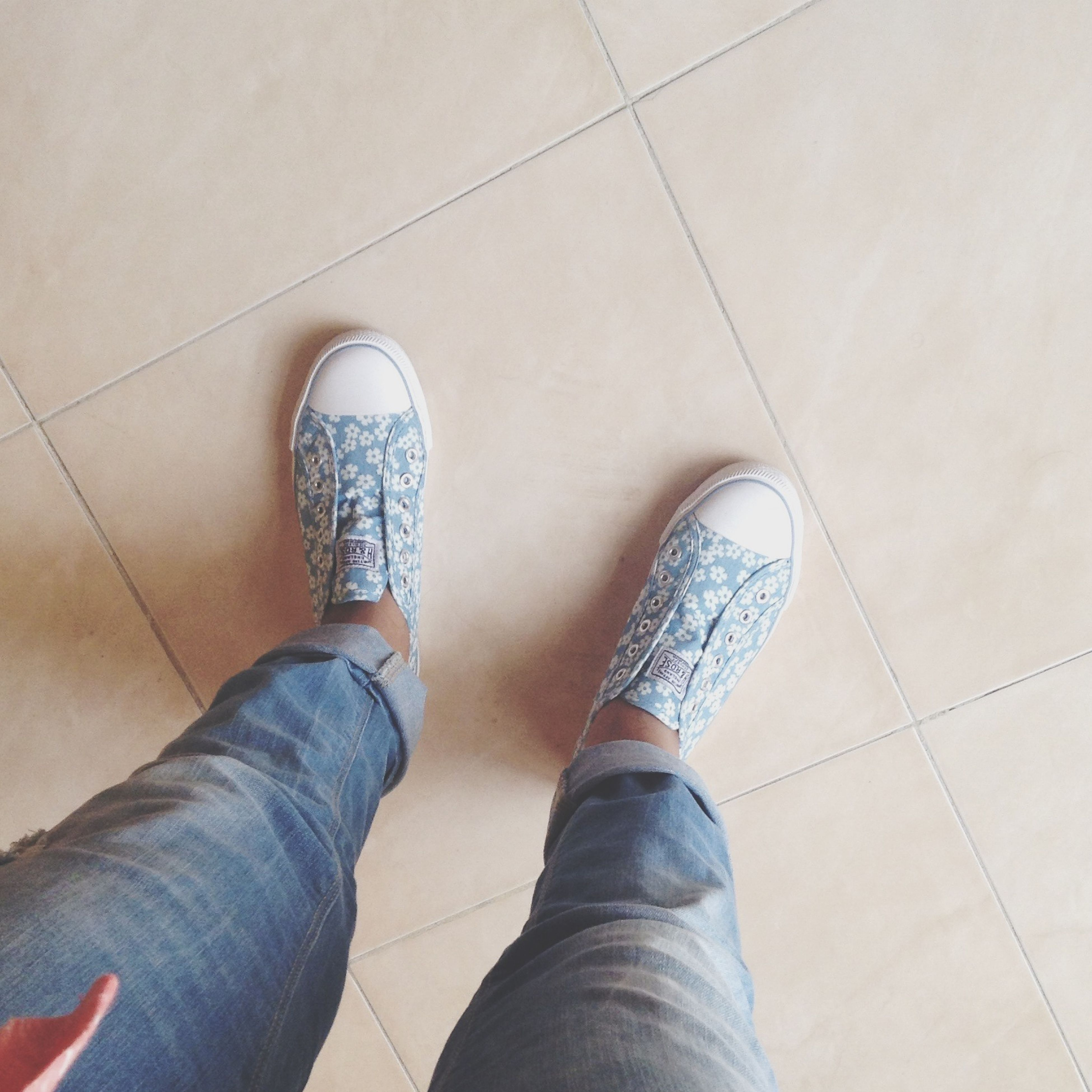 low section, person, shoe, personal perspective, footwear, human foot, high angle view, tiled floor, indoors, jeans, standing, flooring, part of, lifestyles, directly above, floor, unrecognizable person