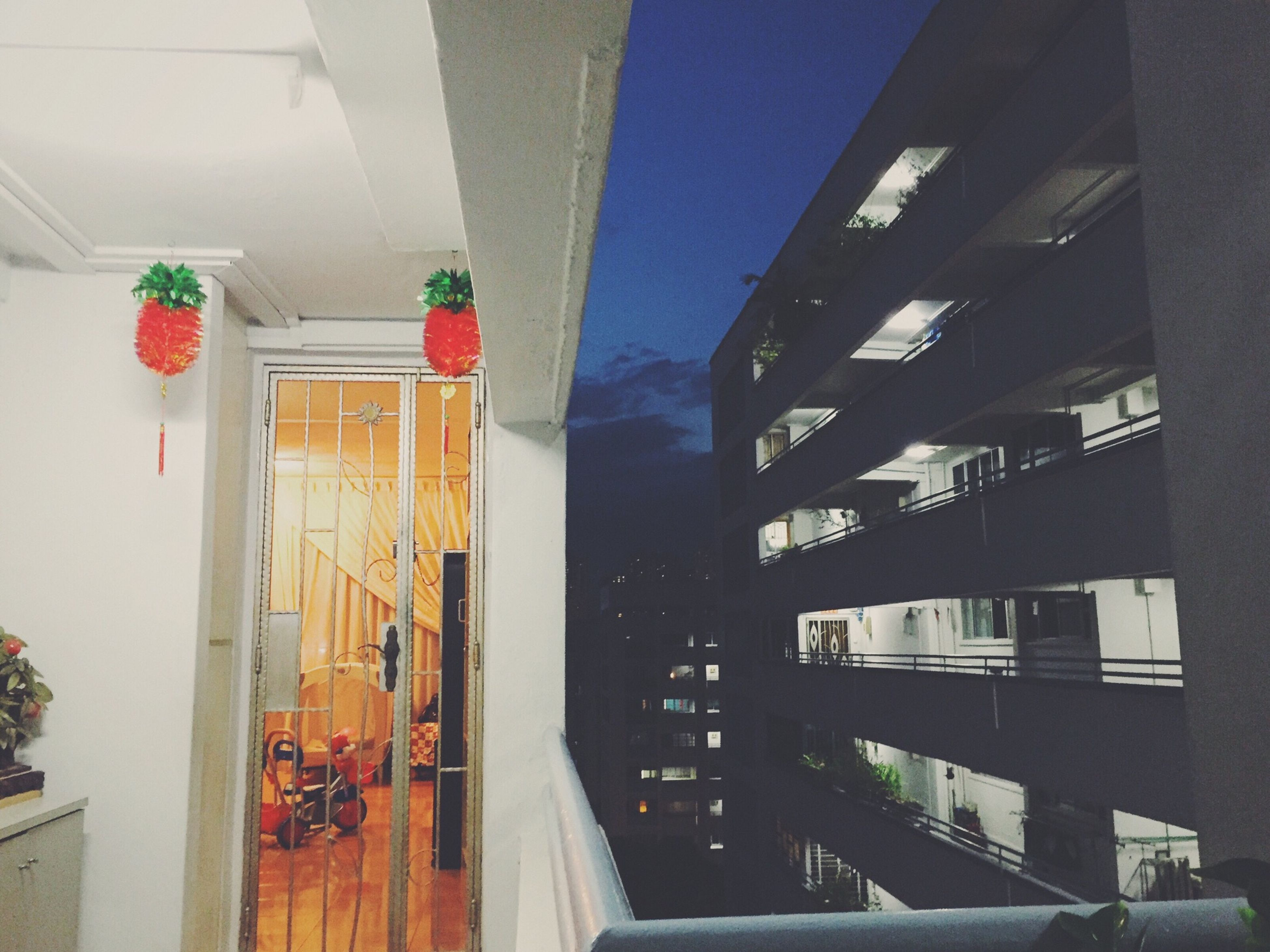 architecture, built structure, building exterior, low angle view, building, indoors, residential building, window, city, residential structure, railing, sunlight, modern, day, balcony, no people, house, in a row, ceiling, glass - material