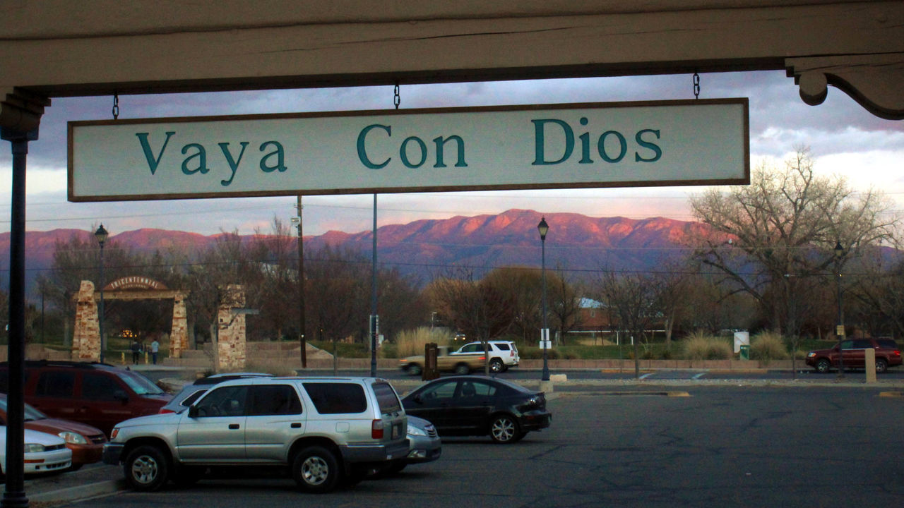 Adapted To The City Albuquerque Cars Juxtaposition Landscape Mountains New Mexico Parking Lot Sandia Mountains Scenics Southwest  Sunset Vaya Con Dios