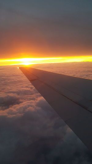 the rising mid-January sunlight streams over the wing of an airliner. Sunrise_Collection Travel Photography Airplane View January 2018