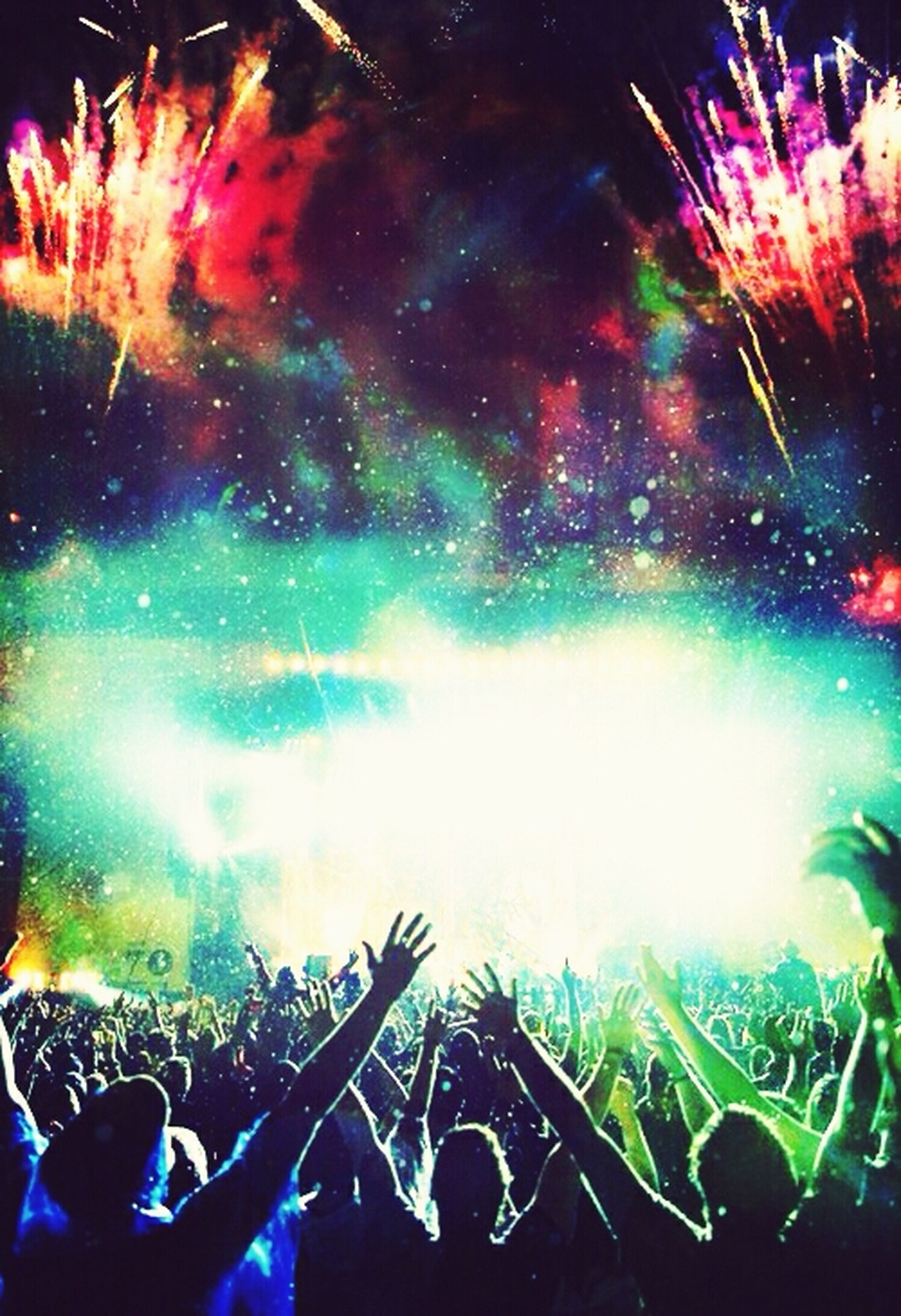 arts culture and entertainment, large group of people, event, lifestyles, leisure activity, crowd, illuminated, night, men, celebration, enjoyment, fun, togetherness, nightlife, person, music festival, popular music concert, music