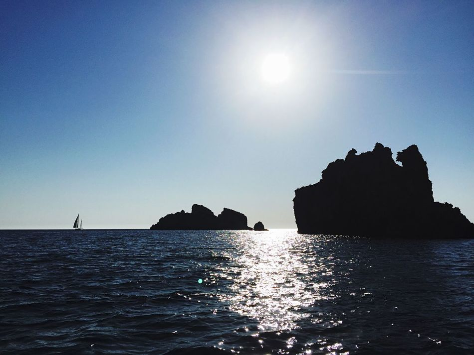 Sea Water Scenics Tranquil Scene Sunlight Silhouette Tranquility Clear Sky Beauty In Nature Horizon Over Water Rock Formation Waterfront Reflection Blue Nature Idyllic Rock - Object Calm Majestic First Eyeem Photo