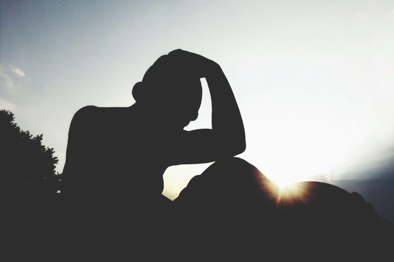 Silhouette Man Sitting Against Sky