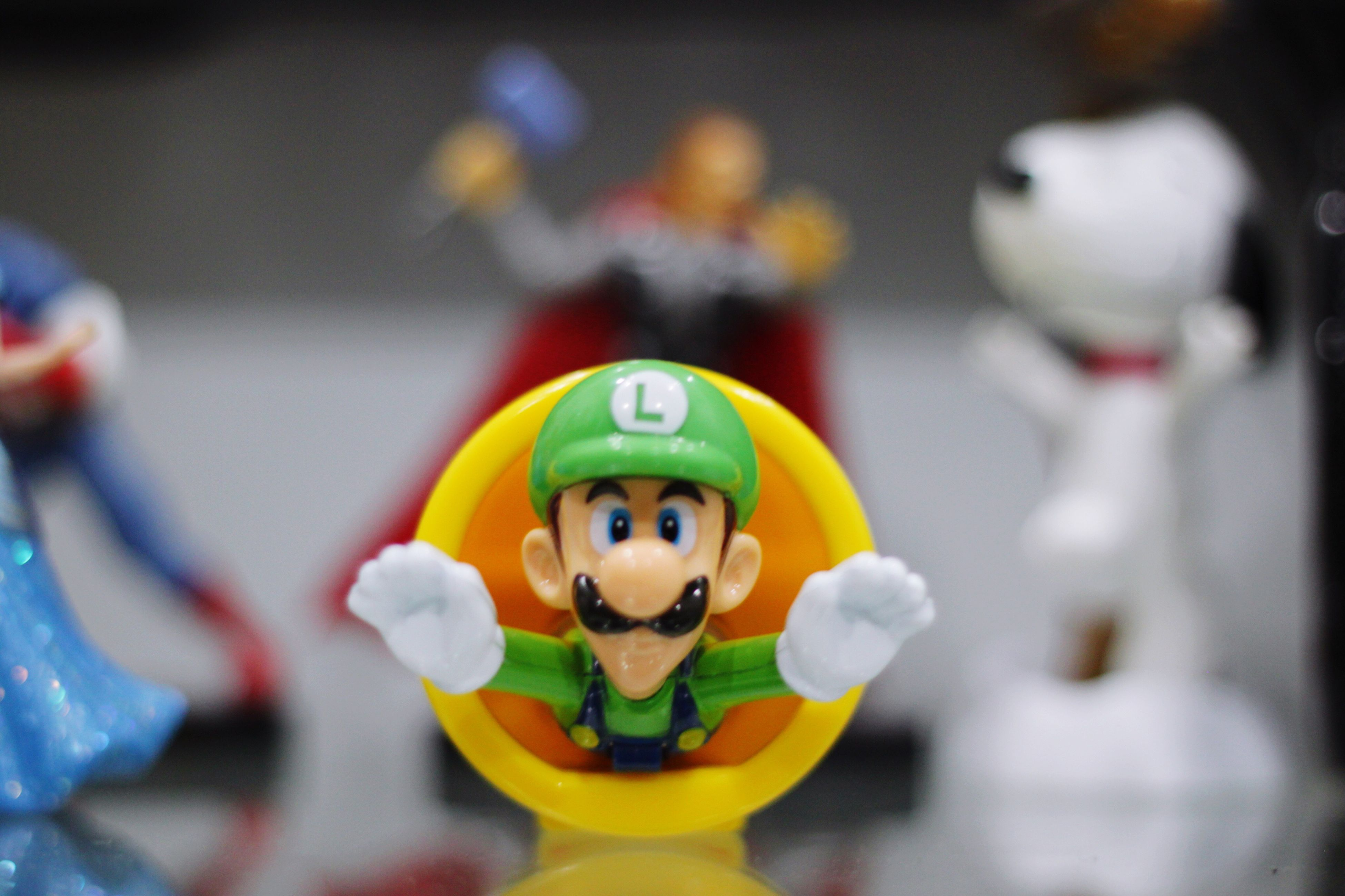 human representation, male likeness, toy, art and craft, focus on foreground, figurine, selective focus, helmet, indoors, no people, close-up, day, anthropomorphic face, clown
