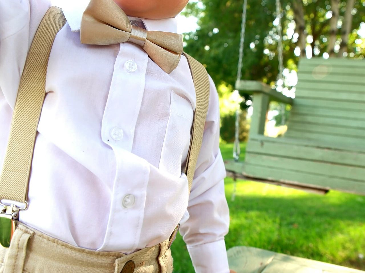 Dressed Up Suspenders Belly Boy Child No Face Wedding Green Color Grass Childhood Bowtie Bow Tie Ring Bearer Wedding Day Marriage  Wedding Details Weddings Wedding Photos Weddinginspiration Wedding Photography Close-up Weddingday  Weddings Around The World Wedding Ceremony Celebration Event