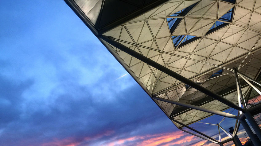 Stansted Airport Early Evening Architectural Feature Architecturalphotography Architecture Built Structure Development Engineering Eyeem Architecture Lover Fosterandpartners Glass - Material London Stansted Airport Low Angle View Modern No People Norman Foster Perspective Silhouette Sky Skylight Stanstead Airport Stansted Airport Structure Sunset