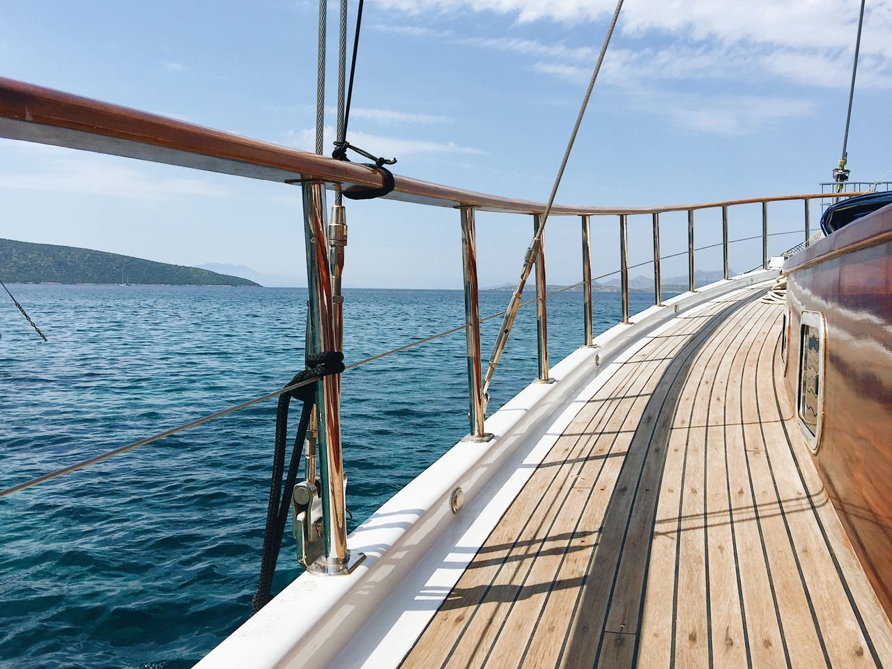 sea, water, sky, railing, nautical vessel, transportation, mode of transport, no people, day, nature, cloud - sky, wood - material, outdoors, boat deck, sailing, horizon over water, beauty in nature, scenics, sailing ship, close-up